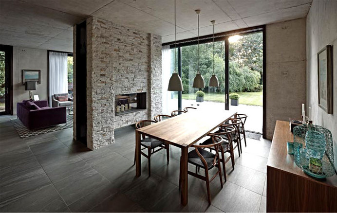 Suburban Home with Concrete Structure that is Exposed Throughout the Interior building concrete structure exposed interior #interior #dining #design #area #table