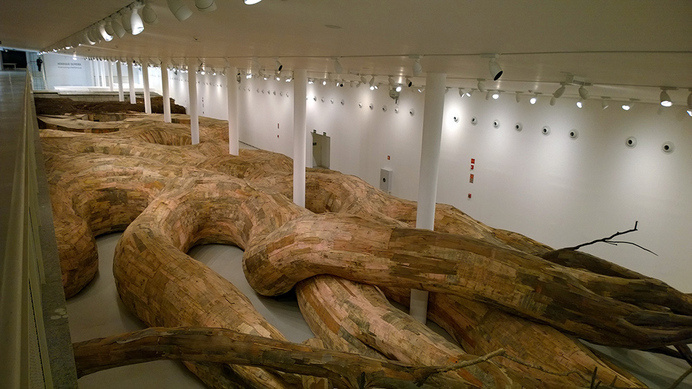 Henrique Oliveira Constructs a Cavernous Network of Repurposed Wood Tunnels at MAC USP #wood #installation