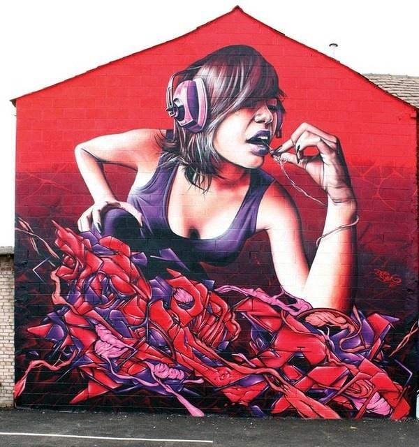 Realistic graffiti street art with woman