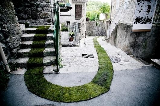 grass carpet winds through a french village #france #carpet #art #grass