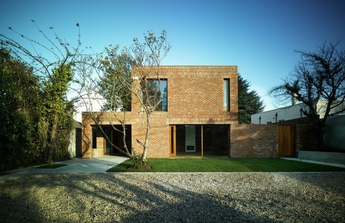 Renewed Home in Dublin Boasting Wooden Details And A Brick Fence Read more: http://freshome.com/architecture/#ixzz37rpLOiER