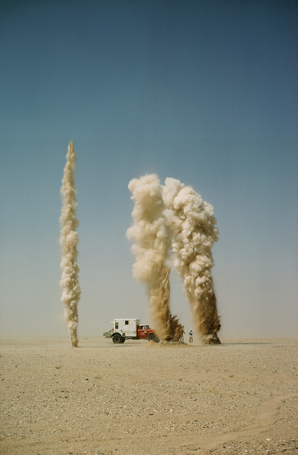 Geysers of sand explode as geologists probe for oil bearing land in Saudi Arabia, January 1966.Photograph by Thomas J. Abercrombie, National