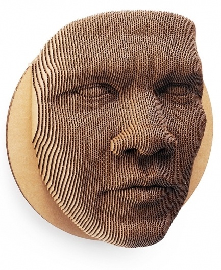An 87-piece topographical cardboard face mask | Colossal #mask #sculpture #paper #cardboard