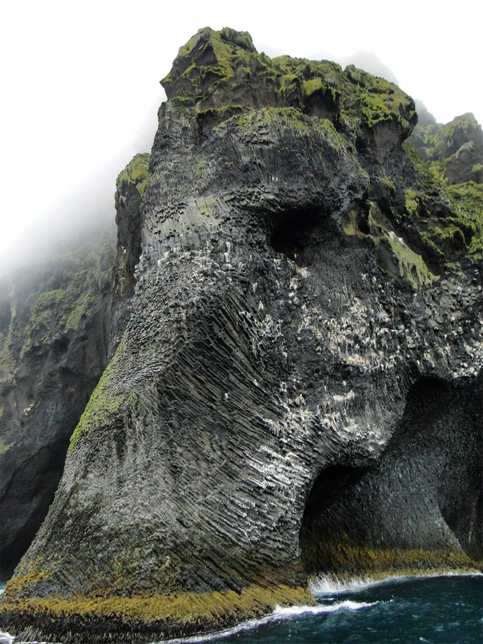 An Elephant Appears to emerge from a cliff