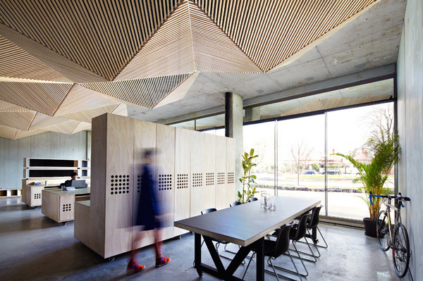 assemble studio features geometric origami ceiling #office