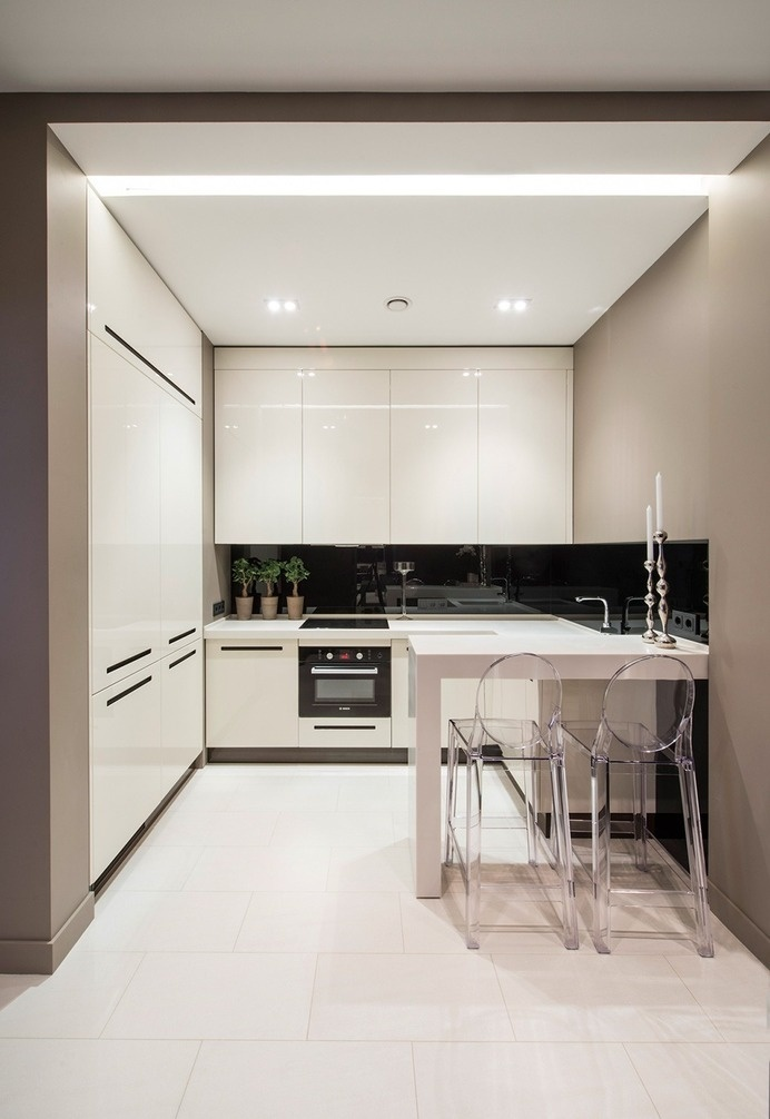 Tiny Small Compact white kitchen with floor to ceiling cupboards and black splashback. #interior #kitchen