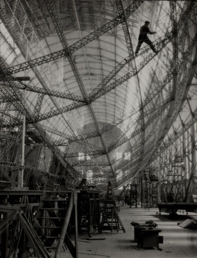 Skeleton of Graf Zeppelin - we make money not art #steel #white #zeppelin #construction #black #flying #and