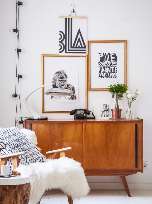 Black and white graphic artwork and vintage wooden furniture