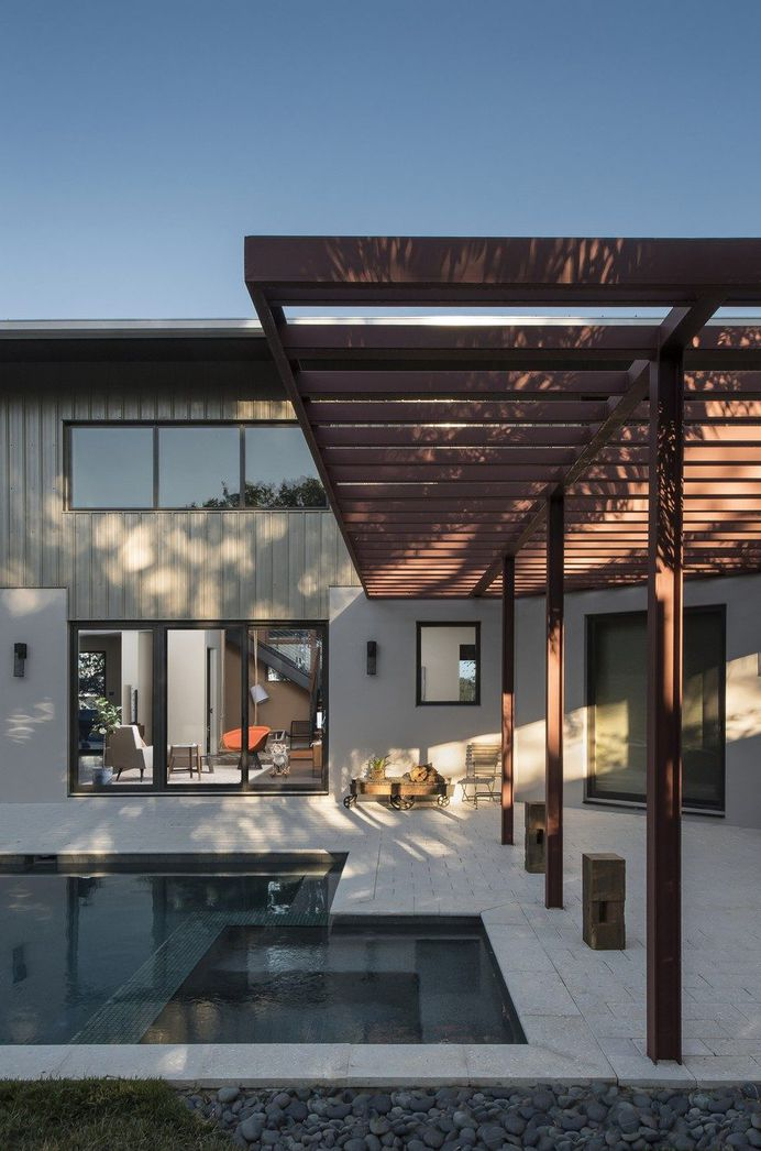 Interstruct, Inc. Turned a Former Parking Lot into a Warm and Modern Home 3