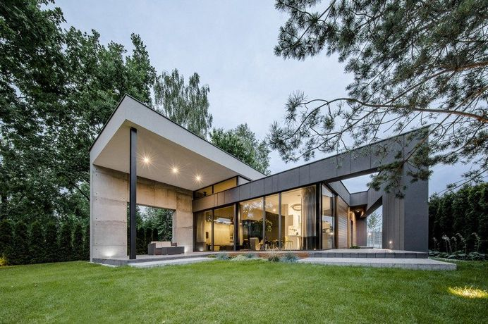 L-Shaped Family Home Exhibiting A Distinctive Roof And Custom Interior