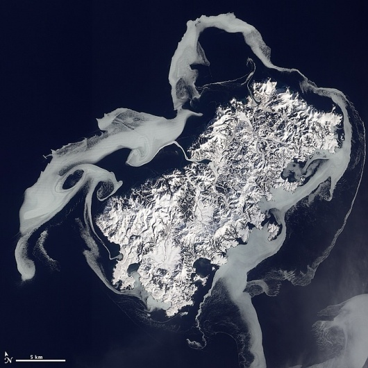 Sea Ice Surrounds Shikotan : Image of the Day #shikotan #photography #volcano #space