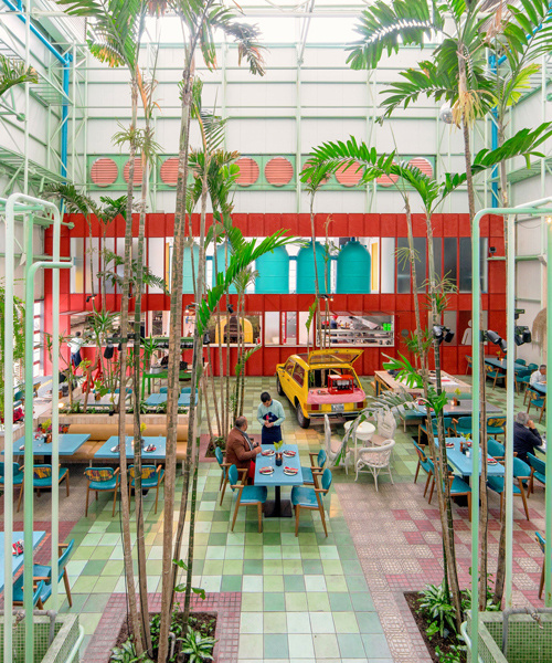 taller KEN populates madero café in guatemala with tropical planting and vintage cars