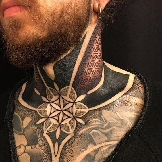 Geometric blackwork neck and chest tattoo