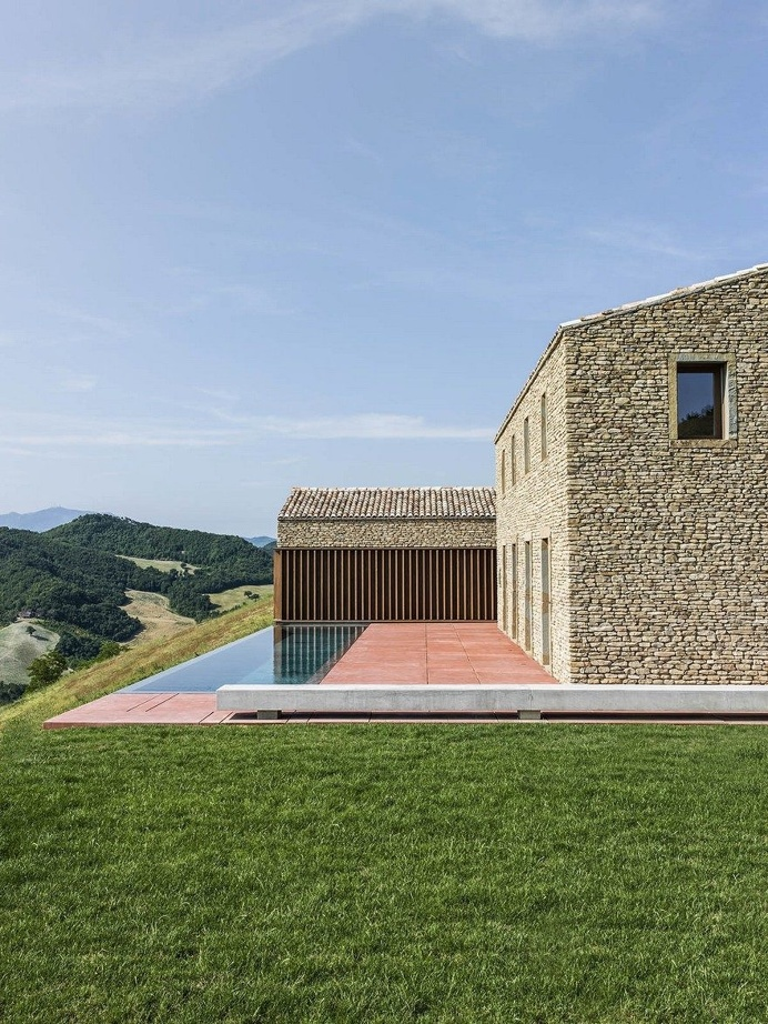 This Italian Stone House Celebrates Vernacular Architecture in a Modern Way