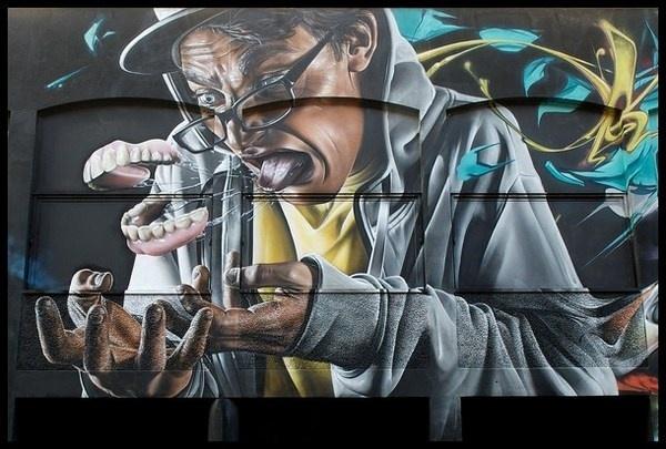 Realistic graffiti on street wall