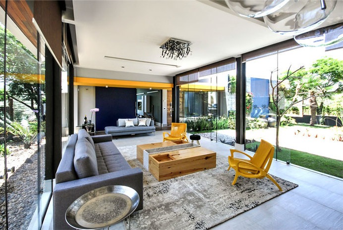 Brazilian House with Stylish Architecture and Rustic Materials vital yellow color chairs #interior #design #decor #living #livingroom #room