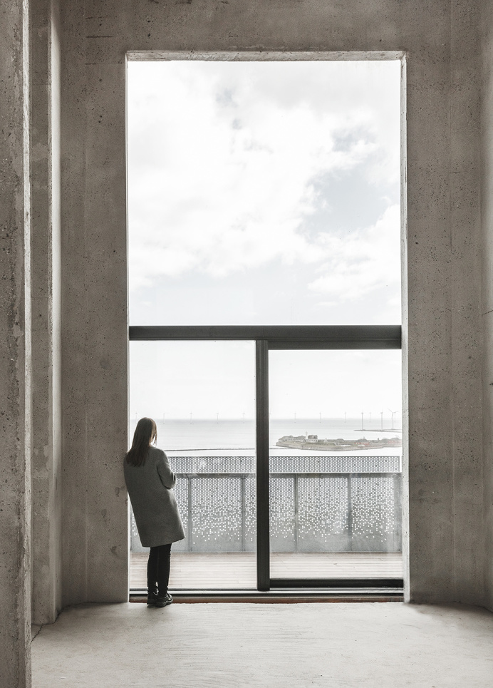 """Window unit and metal panels at """"The Silo"""" by COBE in Copenhagen A former silo in Copenhagen transformed into a stunning residential co"""