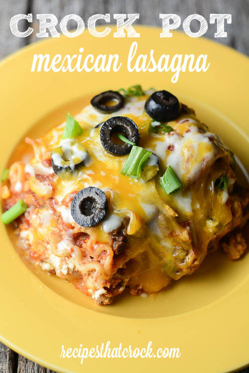 Crock Pot Mexican Lasagna: The perfect slow cooker dish for your next family fiesta! Layers of salsa, noodles, cheese, taco meat and a delic
