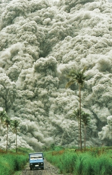 Roiling clouds of superheated ash surge from Mount Pinatubo in the PhilippinesNational Geographic | December 1992 #clouds #philippines #cloud #geographic #ash #photography #vulcano #national