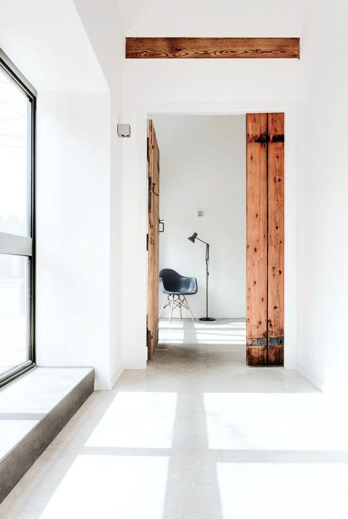 Hallway with old wooden door. The Stables by AR Design Studio. © Martin Gardner. #hallway