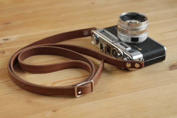 My grandparents Yashica electro 35GSN. I love shooting with this. I recently finished the leather strap for it. #electro #35mm #strap #camera #handmade #leather #yashica