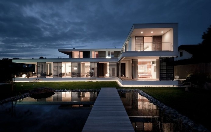 A Better Version of an L-Shaped Villa Hovering Above the Garden in Austria #architecture