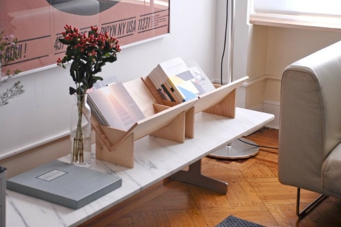 Are you a #book lover with an affinity for #design? This sleek, #minimalist #bookcase allows you to display any book no matter its size!