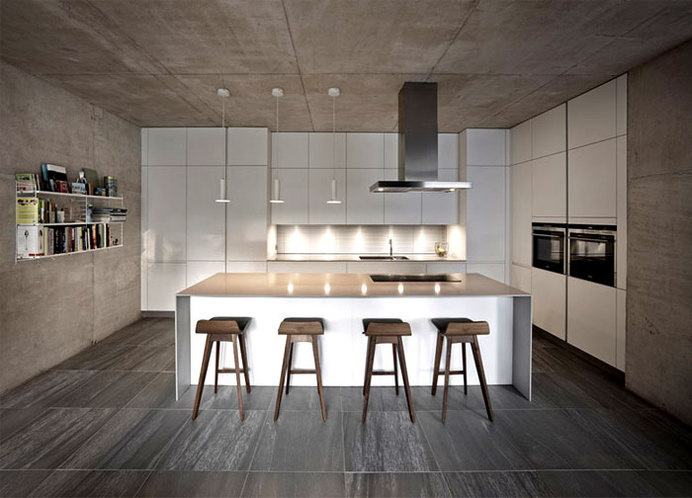 Suburban Home with Concrete Structure that is Exposed Throughout the Interior westmorland house kitchen #interior #kitchen #design