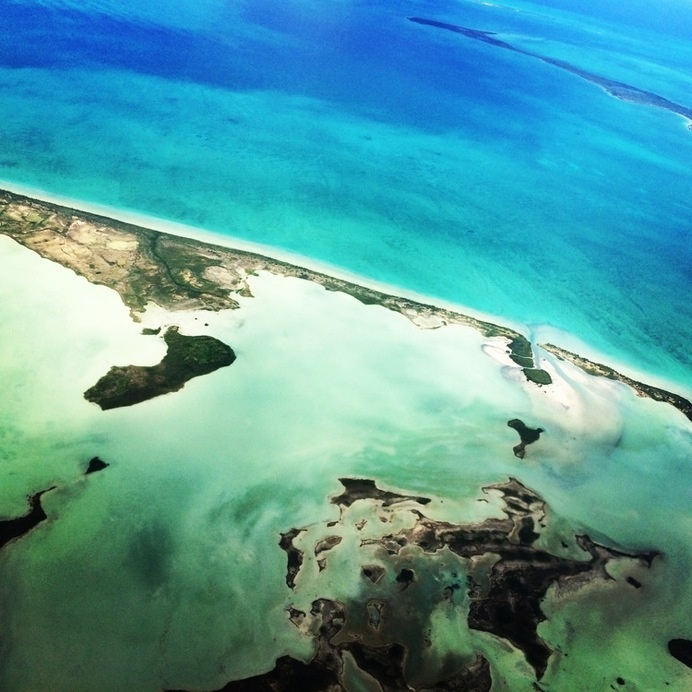 www.kayleighryleydesign.com flies to Belize! #belize #ocean #aerial #airplane #sky #photography #scuba #blue