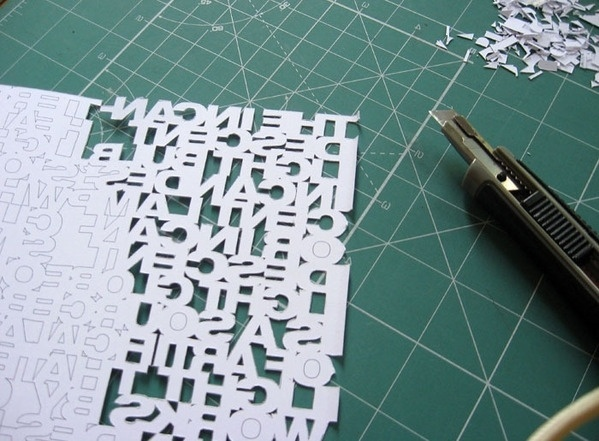 Typo Lamp on the Behance Network #letters #blade #exacto #cutting #paper #typography