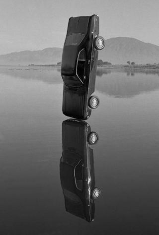 http://www.artsjournal.com/anotherbb/assets_c/2009/05/cardrop-7246.html #gonzalo #white #house #black #muerte #vida #cars #art #short #campari #lebrija #life