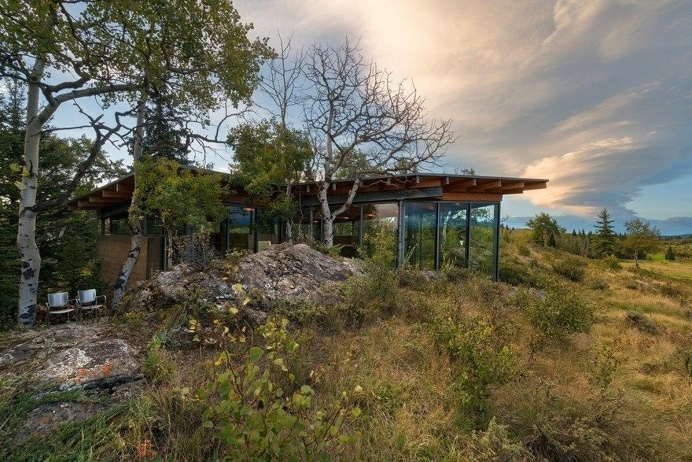 One-Bedroom Cabin Nestled Between Two Massive Lichen-Covered Rocks