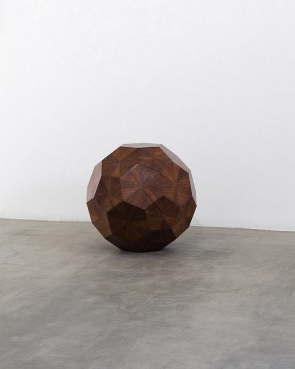 "Weiwei ""Wooden ball"" in exhibition with curator Norman Foster"
