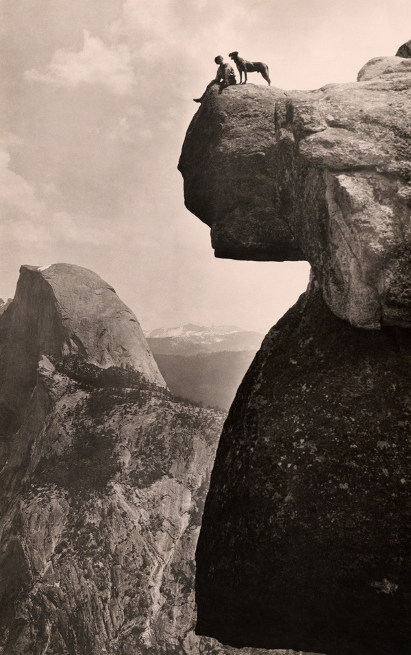 A man and his dog on the Overhanging Rock in Yosemite National Park, May 1924.Photograph by Educational Bruce Photograph #yosemite #geo #rock #landscape #park #nat #overhanging #vintage #film #national