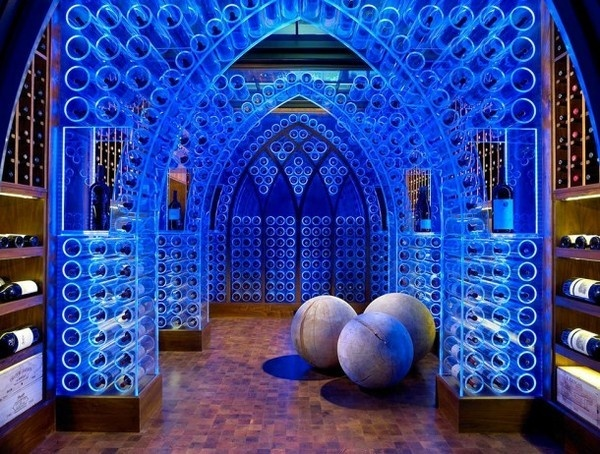 wine cellar with artistic lighting of wine racks in blue in art