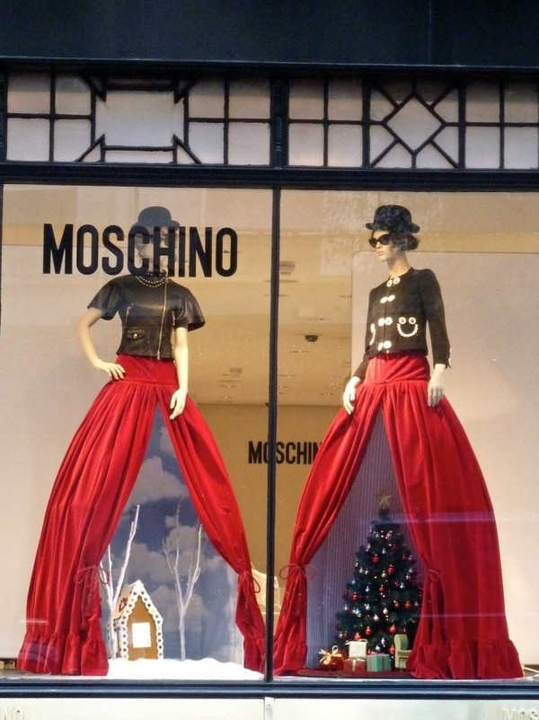 "Christmas display underneath the ""good china"" on the mannequins #window #display"