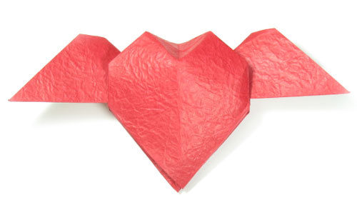 How to make an origami heart with wings (http://www.origami-make.org/howto-origami-heart.php)