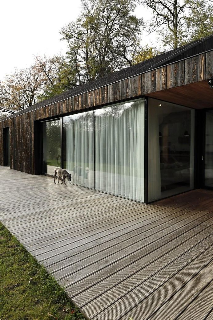 One-Story Family House Covered with Charred Larch Planks 2