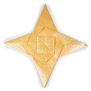 How to make a four-pointed seashell origami star (http://www.origami-make.org/howto-origami-star.php)