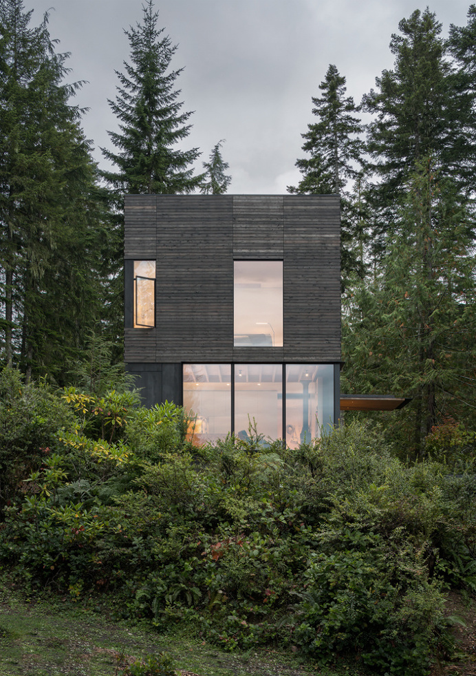 Little House Wrapped in Blackened Timber