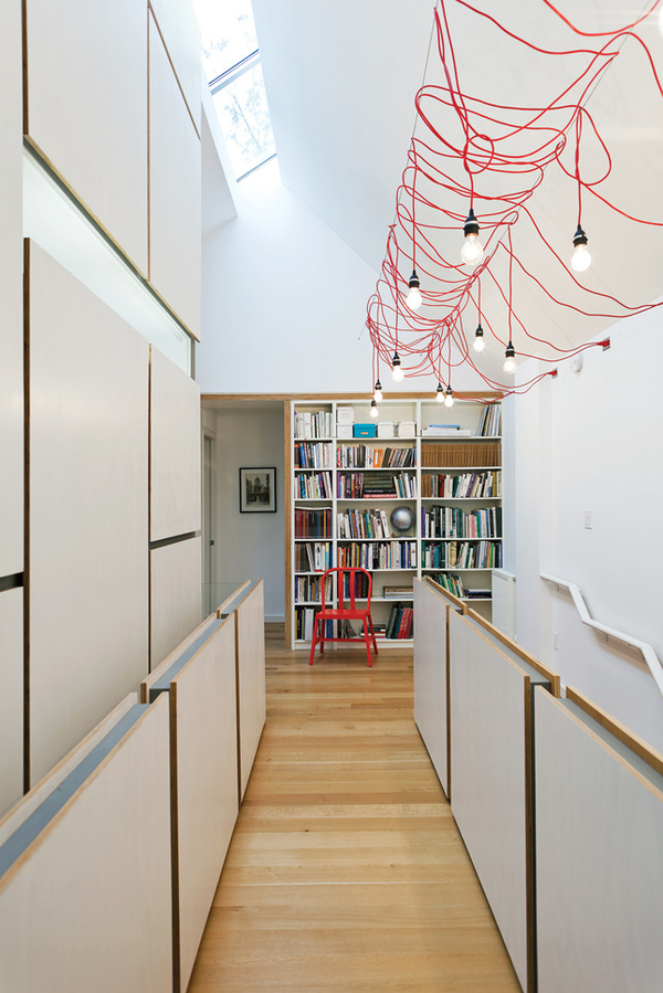 lighting up toronto tudor second story hallway open office library hanging fixtures made from ikea extension cords #interior #design #architecture