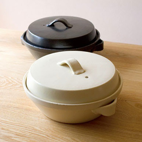 The Modern Donabe Pot is designed to blend into modern living spaces with its sleek shape and clean minimal surface design. Perfect for cooking stews, soups, and Japanese hot pot or 'nabe'. You can take it from your stove and straight to the table! Made in Japan.