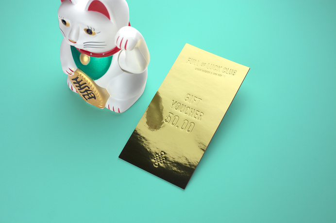 Embossed gold gift voucher by Bravo for modern Cantonese kitchen Full of Luck Club 福乐