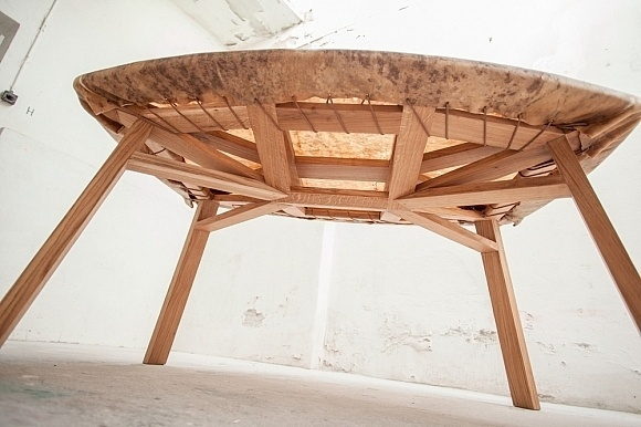 The Hide table is made of oak and cowhide, echoing the wood and the wild ox pelt that early humans would have fashioned into tools and cloth #furniture #design #table