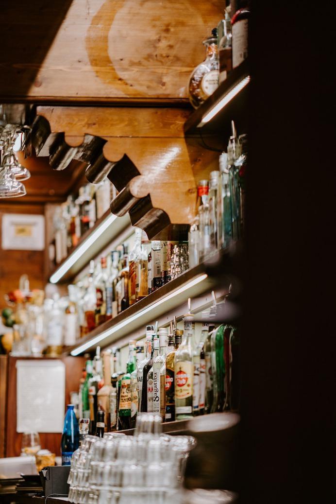 assorted bottles in shelves