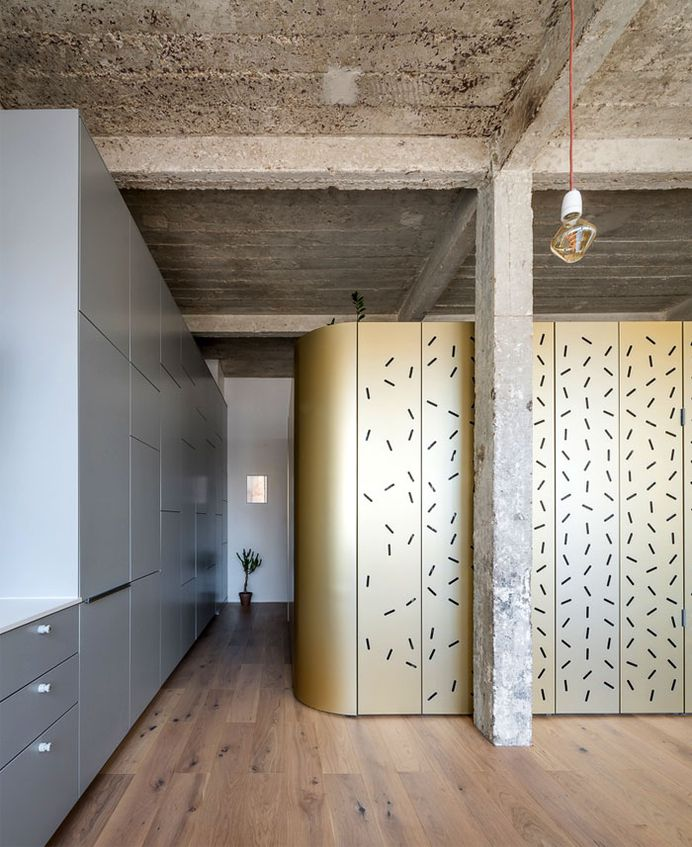 Perforated Aluminum Island at Parisian Apartment by SABO Project - InteriorZine