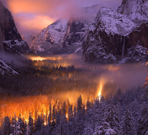 Yosemite Valley at Dusk: A mist had settled over Yosemite Valley, as automobiles passed through, headlights illuminated the fog. (© Phil Ha #national #yosemite #geographic