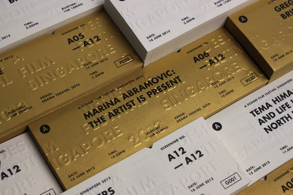 A Design Film Festival Singapore 2013 on Behance #white #invitation #gold #ticket #emboss