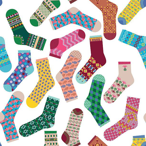 Various multi-colored socks. Seamless background pattern.