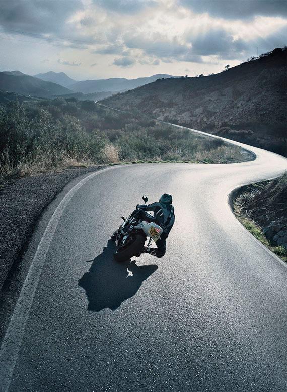 motorbike_rider_on_a_twisting_open_road #rider #motorbike #road